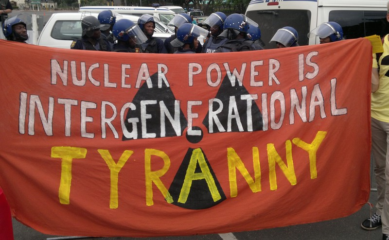 Anti-nuclear banner and police